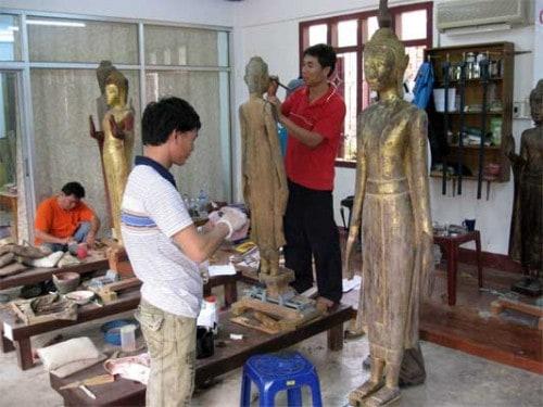 Restoring Wooden Buddha's in Luang Prabang