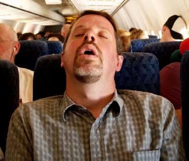 sleeping-on-airplane