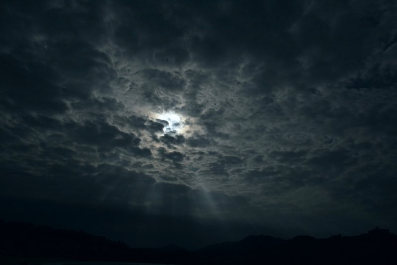 moon beams piercing through clouds - San Sebastian Spain