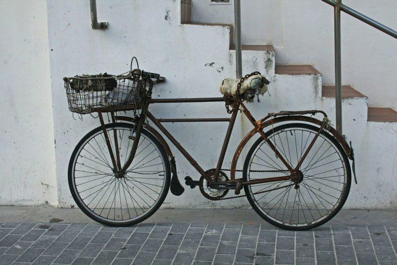 rusty bike near stairs - San Sebastian Spain