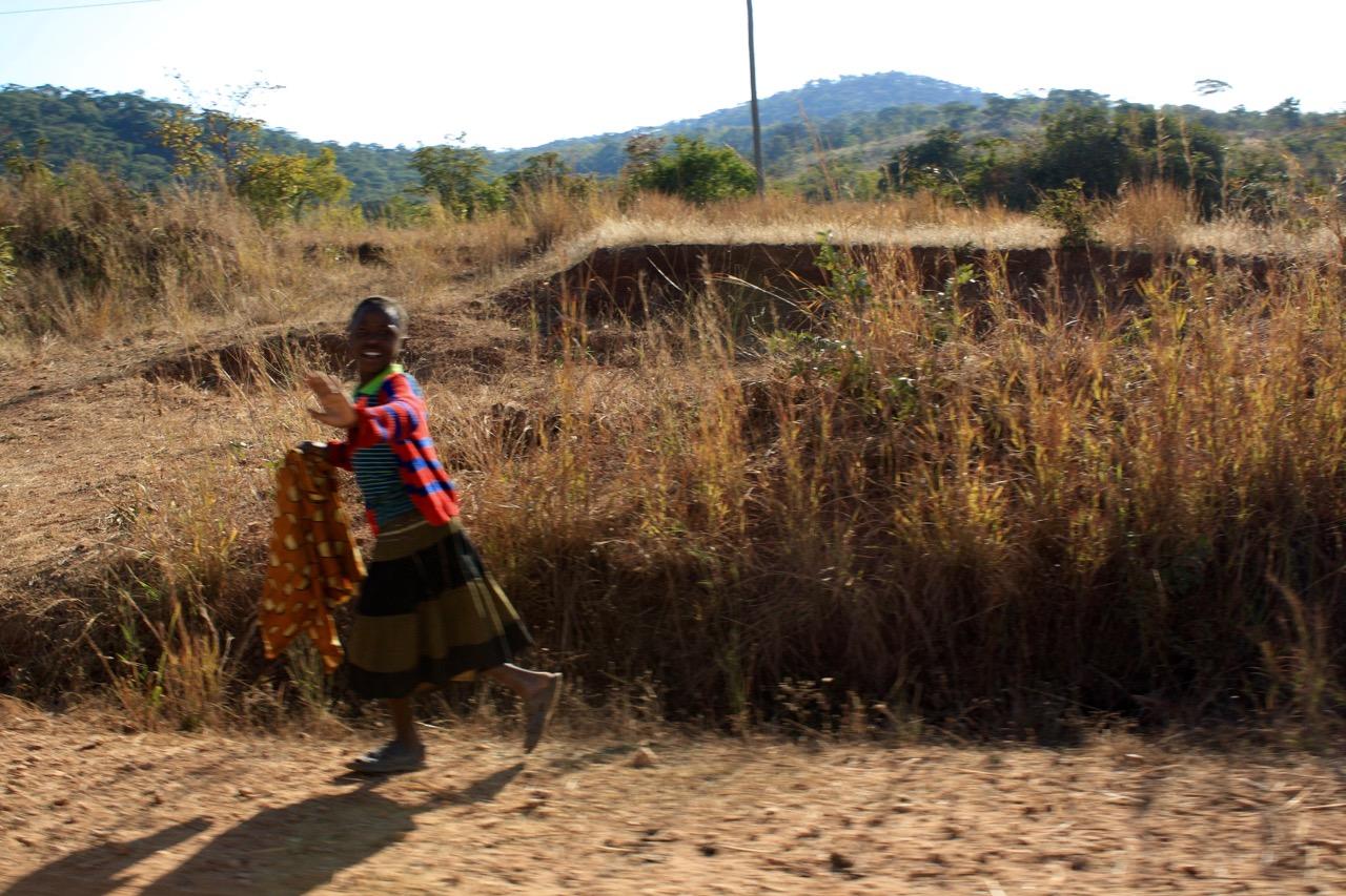 Zambia local waving
