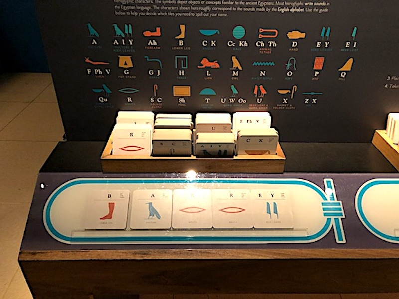 Using hieroglyphic cards to create my name at the Queens of Egypt exhibition at the National Geographic Museum