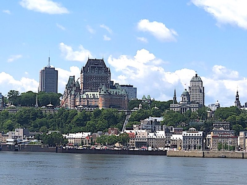 A view of the skyline of Old Quebec City with the Fairmont Le Château Frontenac in the center from the St. Lawrence River